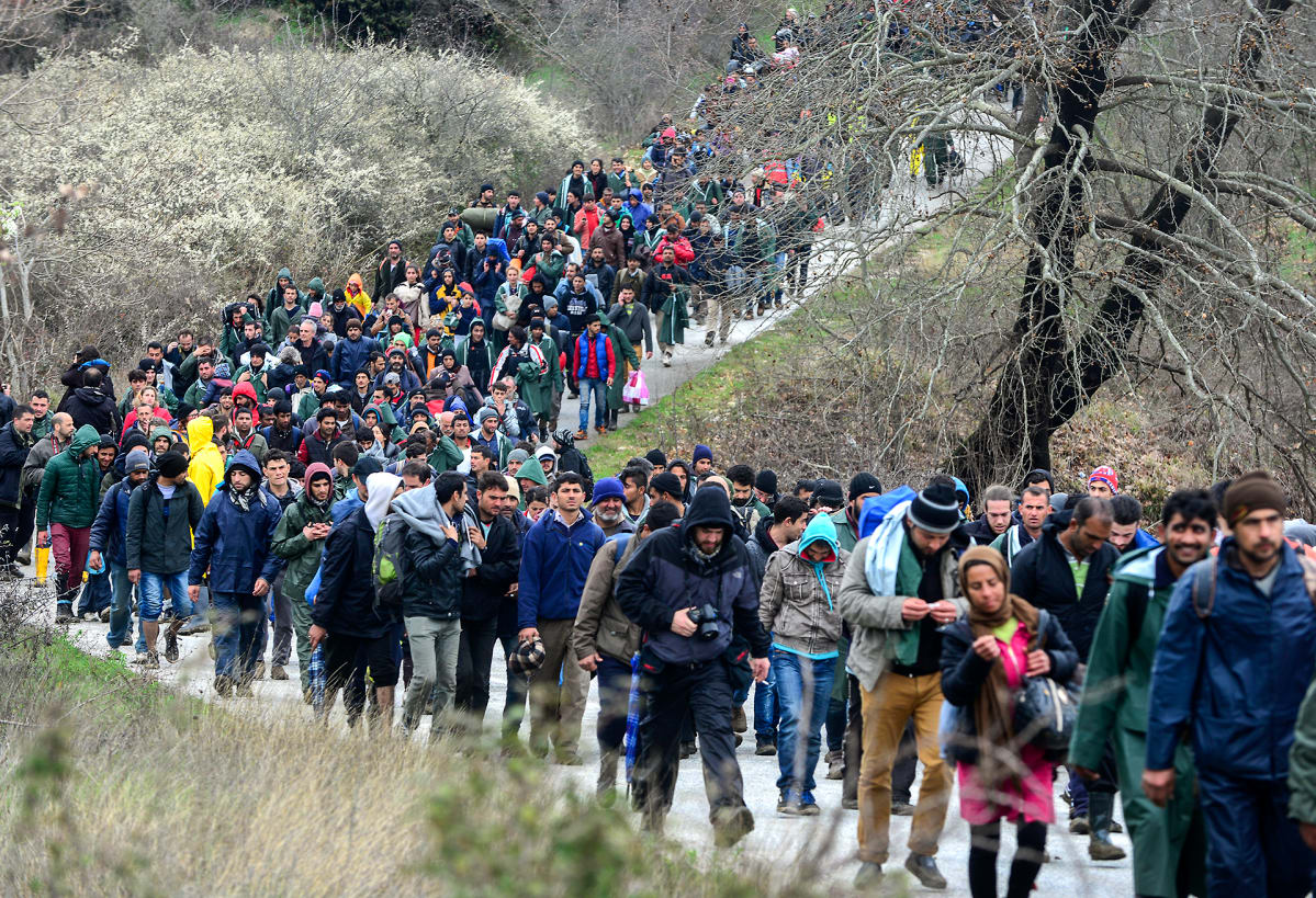 Thousands of refugees wander from the village of Idomen Village in Greece towards the Makedonian border on March 14th.