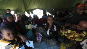 Somali women and children wait to receive treatment at the outpatient clinic run by the African Union in Mogadishu, Somalia