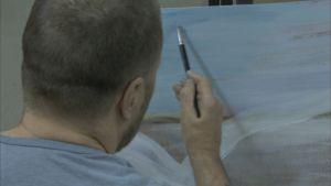 Hannu maalaa Riihimäen vankilassa.