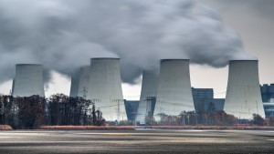 Steam billows out of the cooling towers of the Vattenfall AG brown coal power plant in Jaenschwalde, Germany, 11 November 2015.