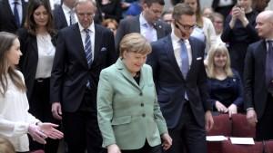 Angela merkel och Alexander Stubb på seminarium.