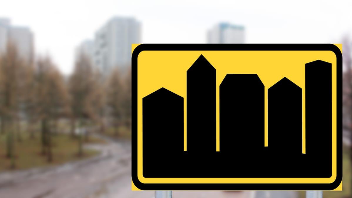 Kuvitteellinen Taajama-alue liikennemerkki