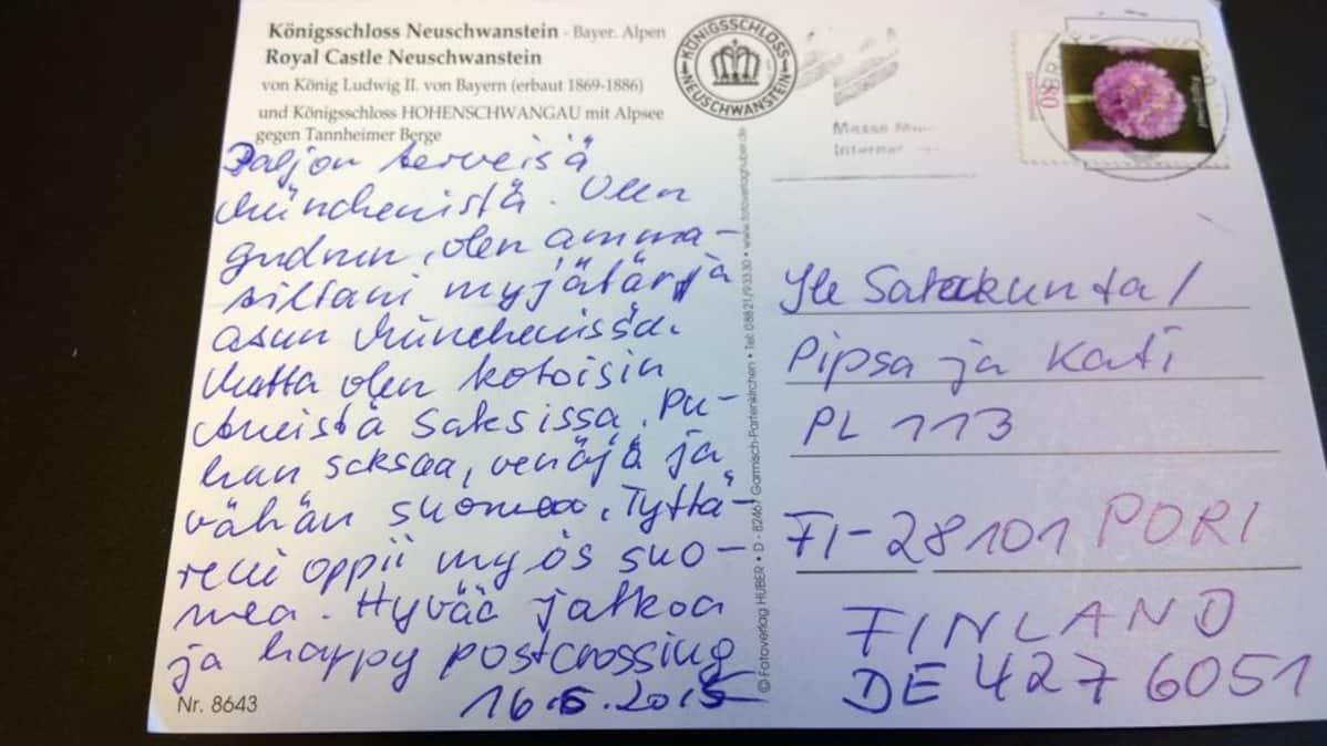 Postikortin takapuoli, jossa tekstiä