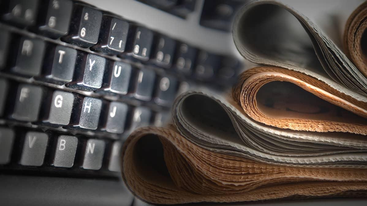 tietokoneen näppis ja sanomalehtiä