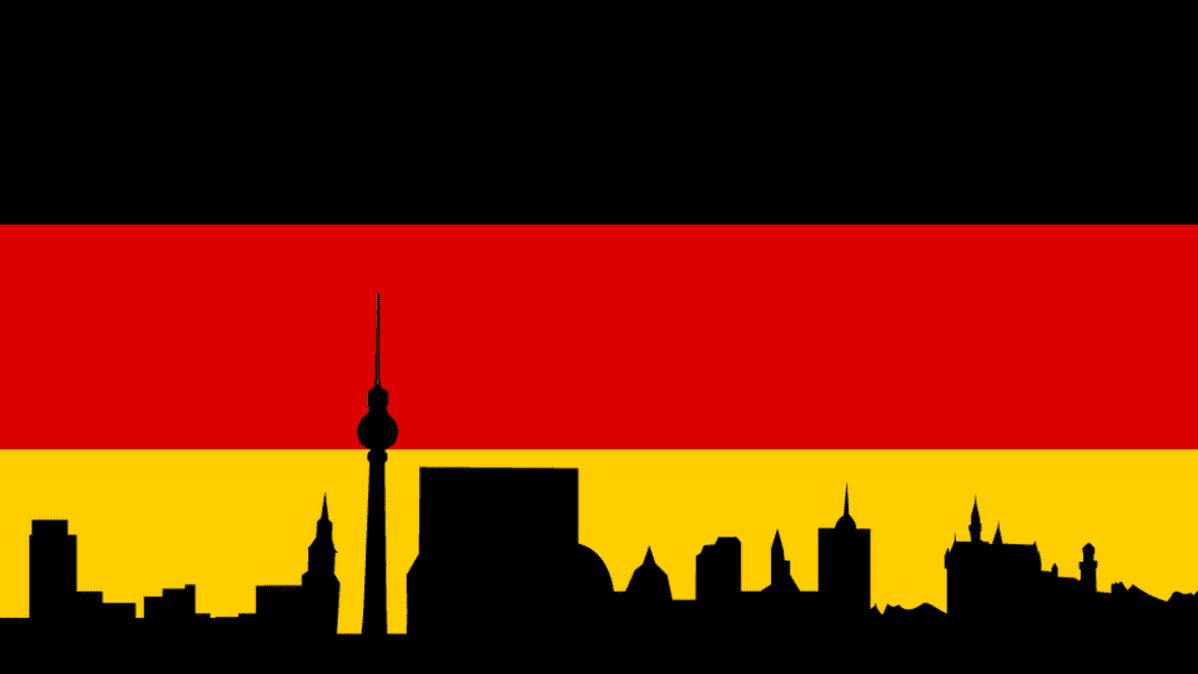 Saksan lippu ja suurkaupungin siluetti