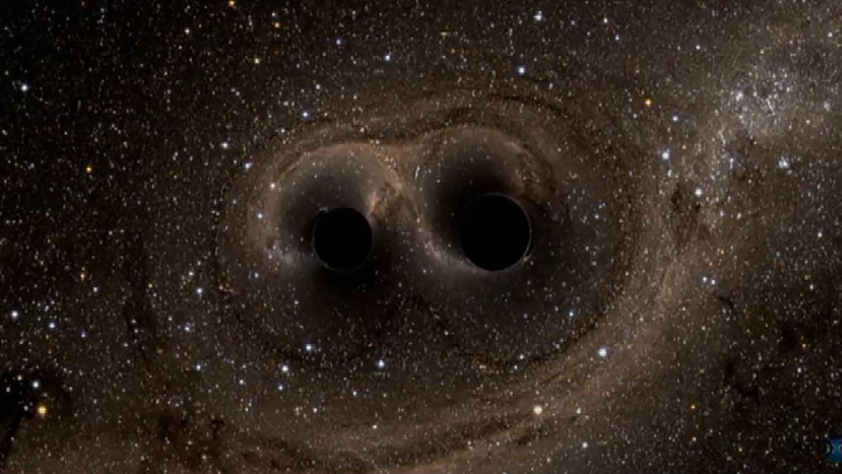Kuva kahdesta mustasta aukosta.
