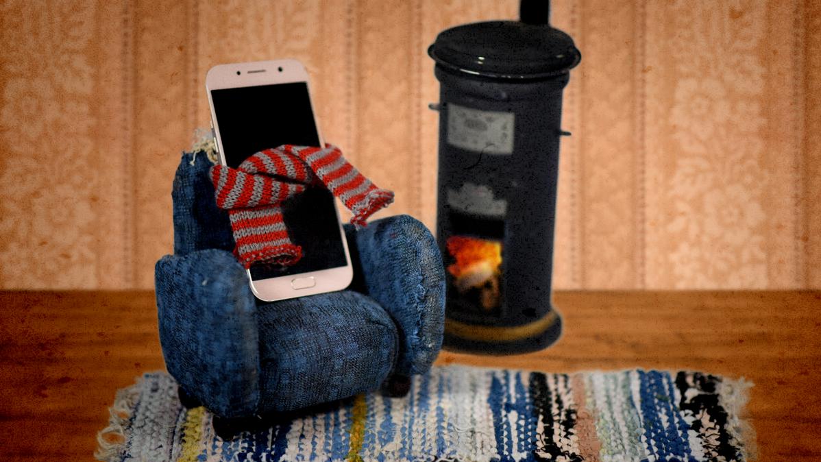 Kuvituskuva, jossa kännykkä istuu nojatuolissa.