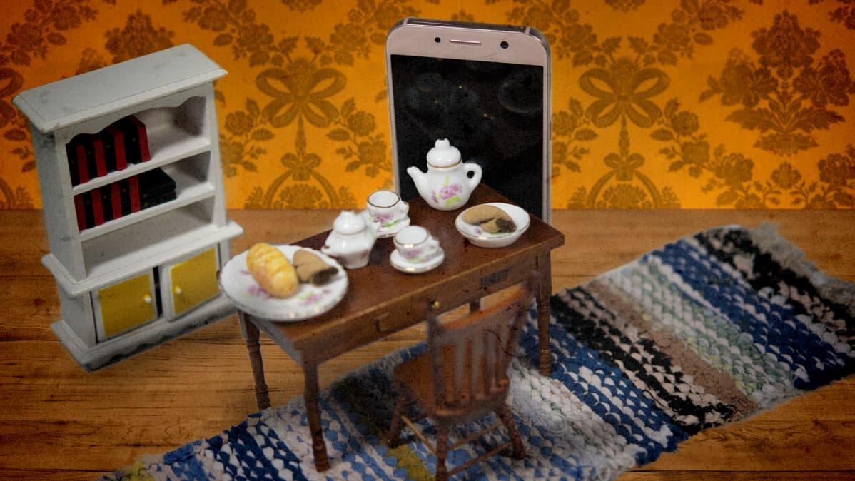 Kuvituskuva, jossa kännykkä seisoo olohuoneessa.