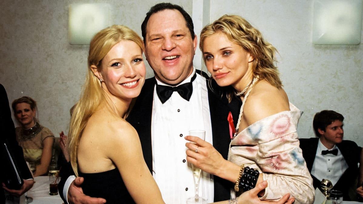 Harvey Weinstein seisoo keskellä, Gwyneth Paltrow ja Cameron Diaz kainalossaan.