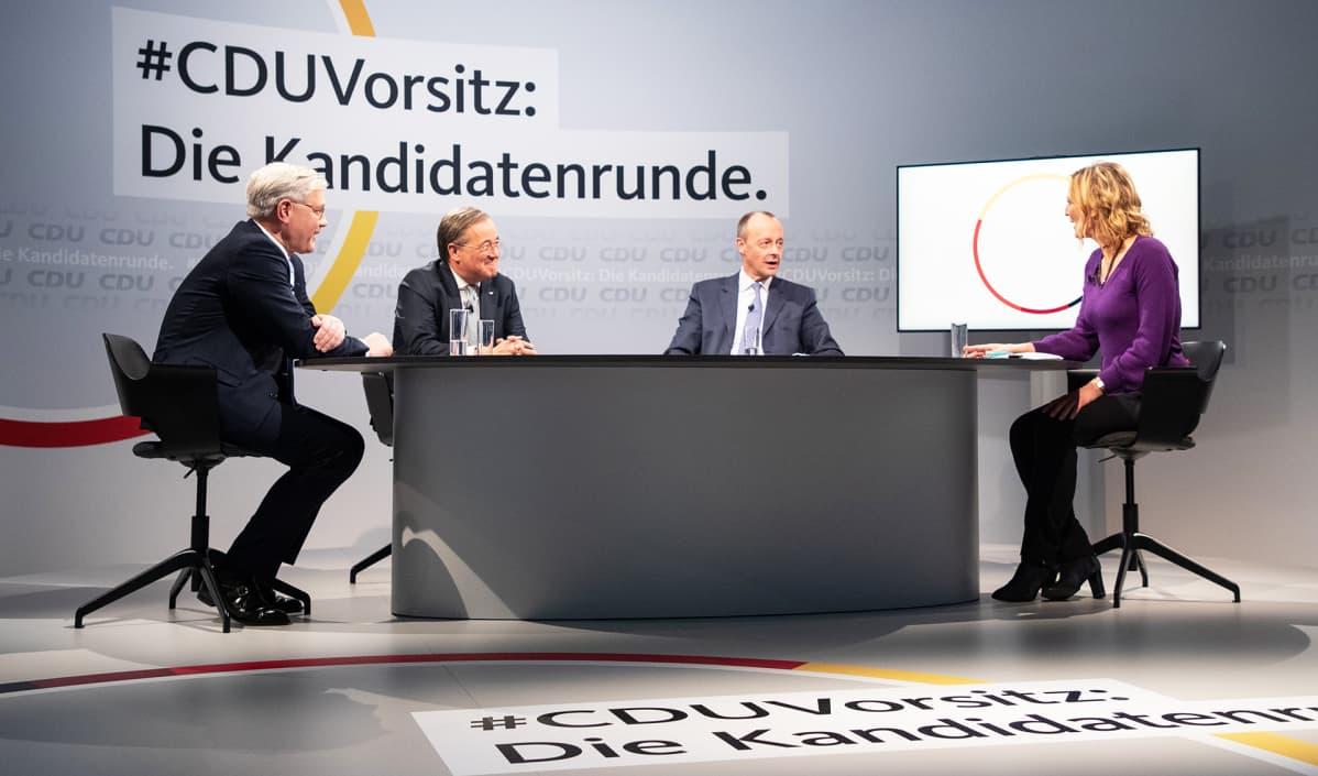 CDU:n puheenjohtajatentissä Norbert Röttgen, Armin Laschet ja Friedrich Merz.