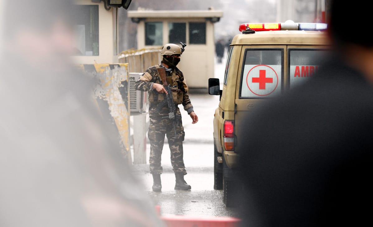 The security officer checks the ambulance in the center of Kabul in Afghanistan.