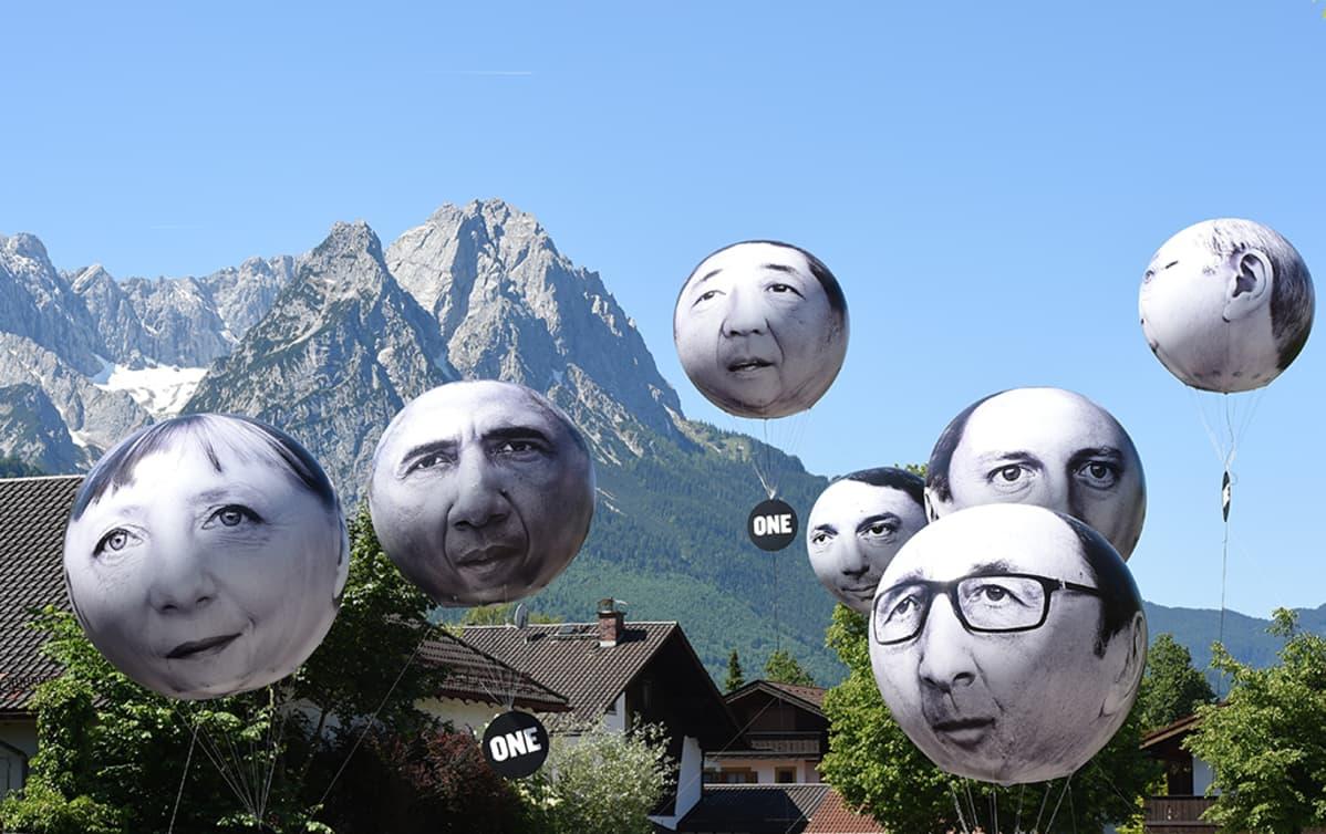 G7-maiden johtajia kuvaavat ilmapallot leijuvat Garmisch-Partenkirchenissä.