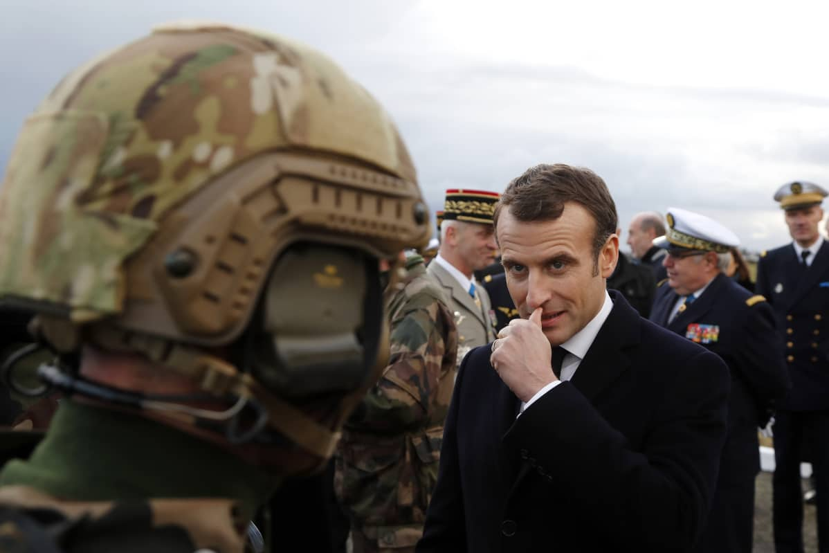 French President Emmanuel Macron meets with paratroopers of the 11th Brigade of the Paratroopers of the Infantry before he delivers his 2019 new year wishes to military forces at Toulouse-Francazal air base near Toulouse, southern France, 17 January 2019. EPA-EFE/GUILLAUME HORCAJUELO