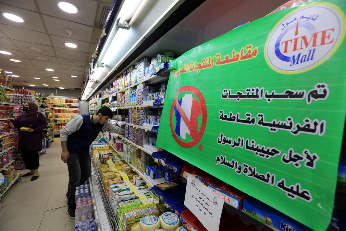 A spot of French products is covered with a placard reading in Arabic 'French products are being boycotted for the sake of the Prophet Muhammad peace upon him', in a supermarket in Amman, Jordan, 26 October 2020. Many people in Jordan called on social media for the boycott of French products as a show of support for Muslims Prophet Muhammad two day before the celebration of the Prophet birthday Mawlid Nabawi on 29 October. The protest call comes amid rising tension in response to French President Macron's comments following the recent beheading of a teacher in France after he had shown cartoons of the Prophet Muhammad in class. Macron vowed his country would not give up publishing such cartoons EPA-EFE/STR ↑