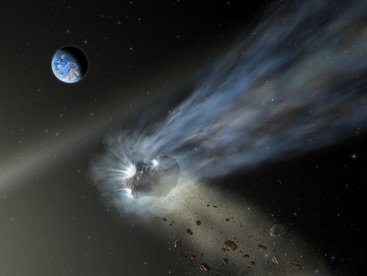 Piirroskuvassa pyrstöllinen komeetta, josta irtoilee pieniä kappaleita, kiitää avaruudessa. Taustalla näkyy maapallo.