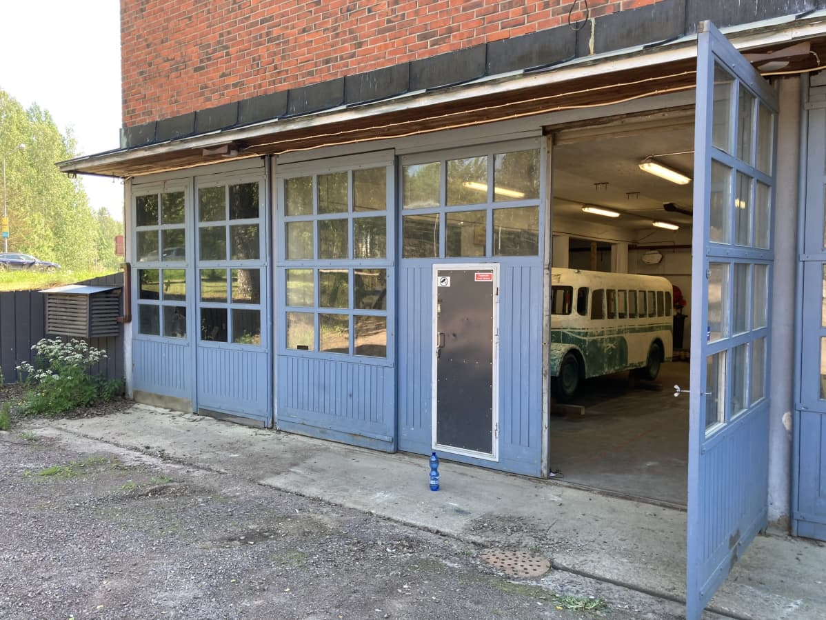 A toy bus peeks out of the garage