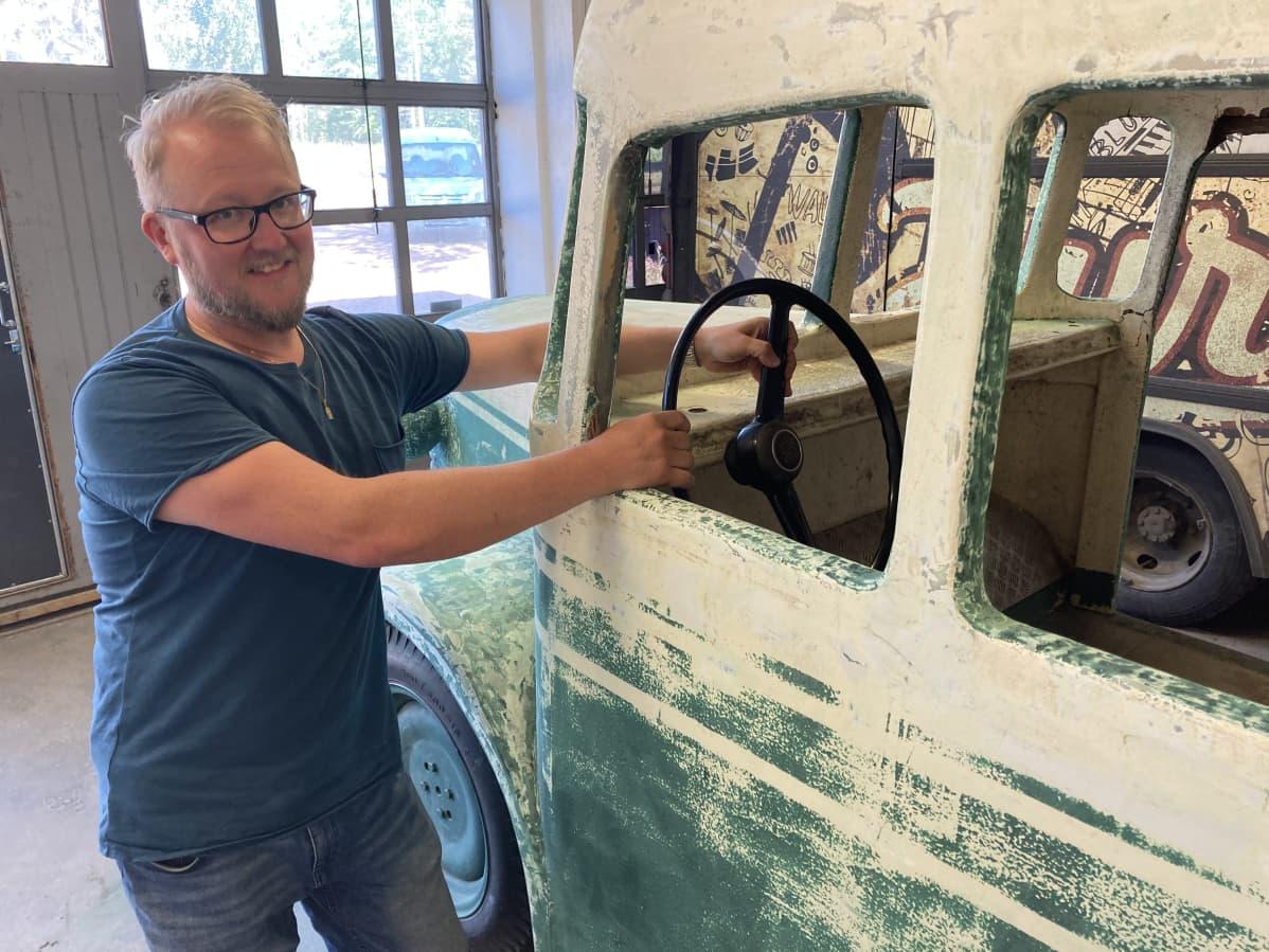 Antti Jyrkilä holds the bus wheel