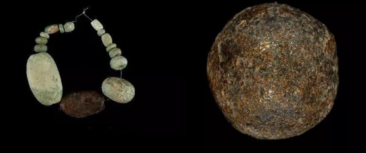 Meripihkakaulakoru ja yksittäinen pyöreä helmi.