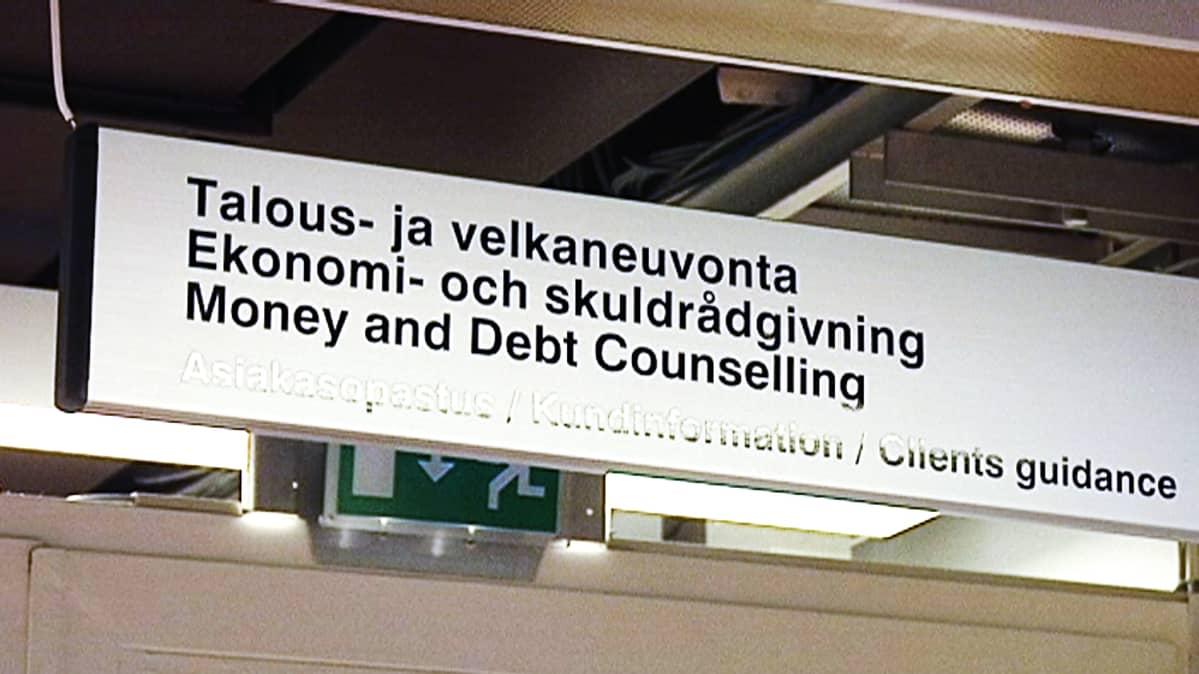 Talous- ja velkaneuvonta -kyltti velkaneuvojan toimistossa.