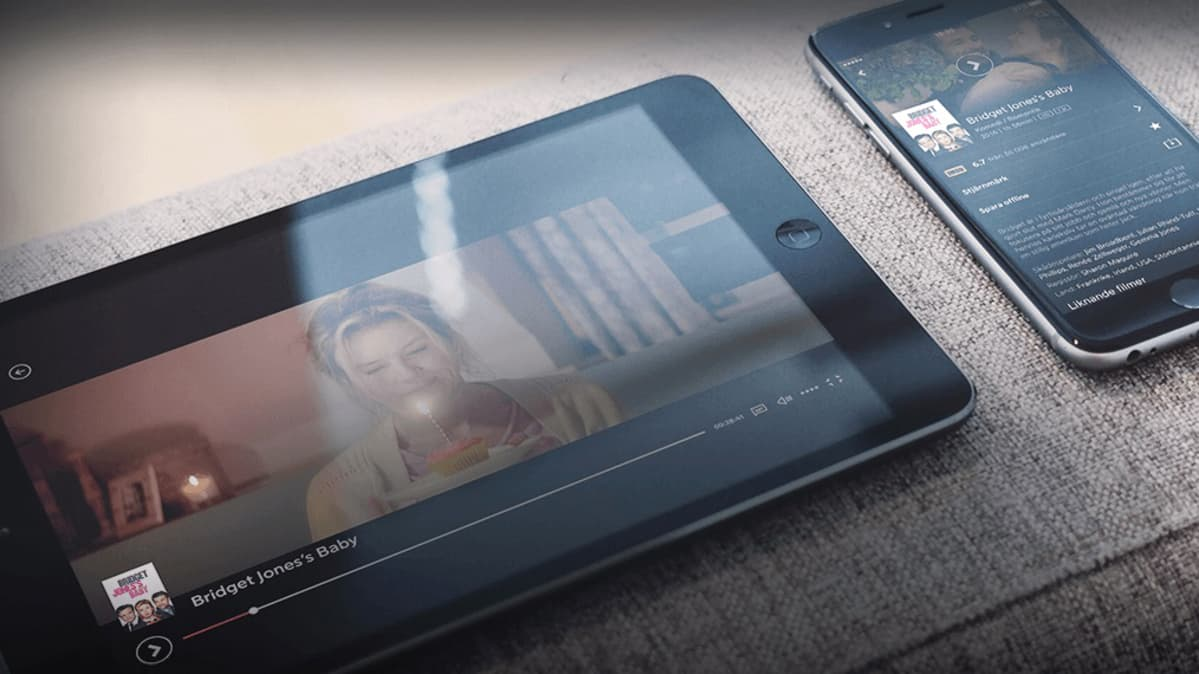 Tabletti ja älypuhelin, jonka näytöllä näkyy ote Bridget Jones's Baby -elokuvasta.