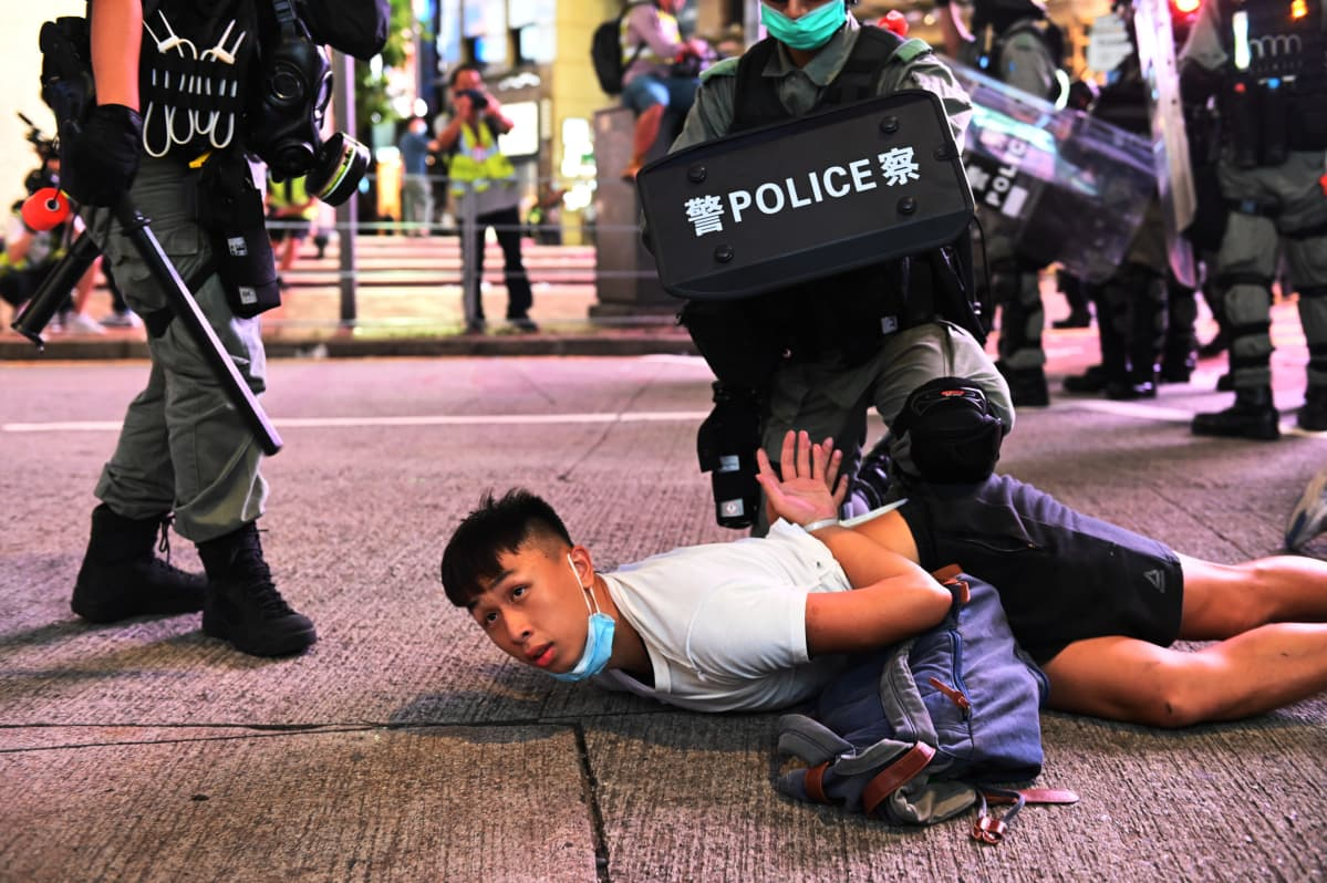 Police officers detain protesters during a rally against a new national security law on the 23rd anniversary of the establishment of the Hong Kong Special Administrative Region in Hong Kong, China, 01 July 2020.