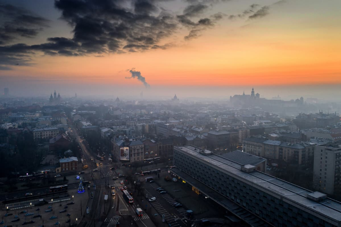 An aerial picture taken with a drone shows a wispy blanket of smog over Krakow, southern Poland, 11 January 2021. Despite movement restrictions implemented to stem the spreading of the coronavirus disease (COVID-19) pandemic, air pollution levels across Krakow still remain relatively high. EPA-EFE/LUKASZ GAGULSKI POLAND OUT