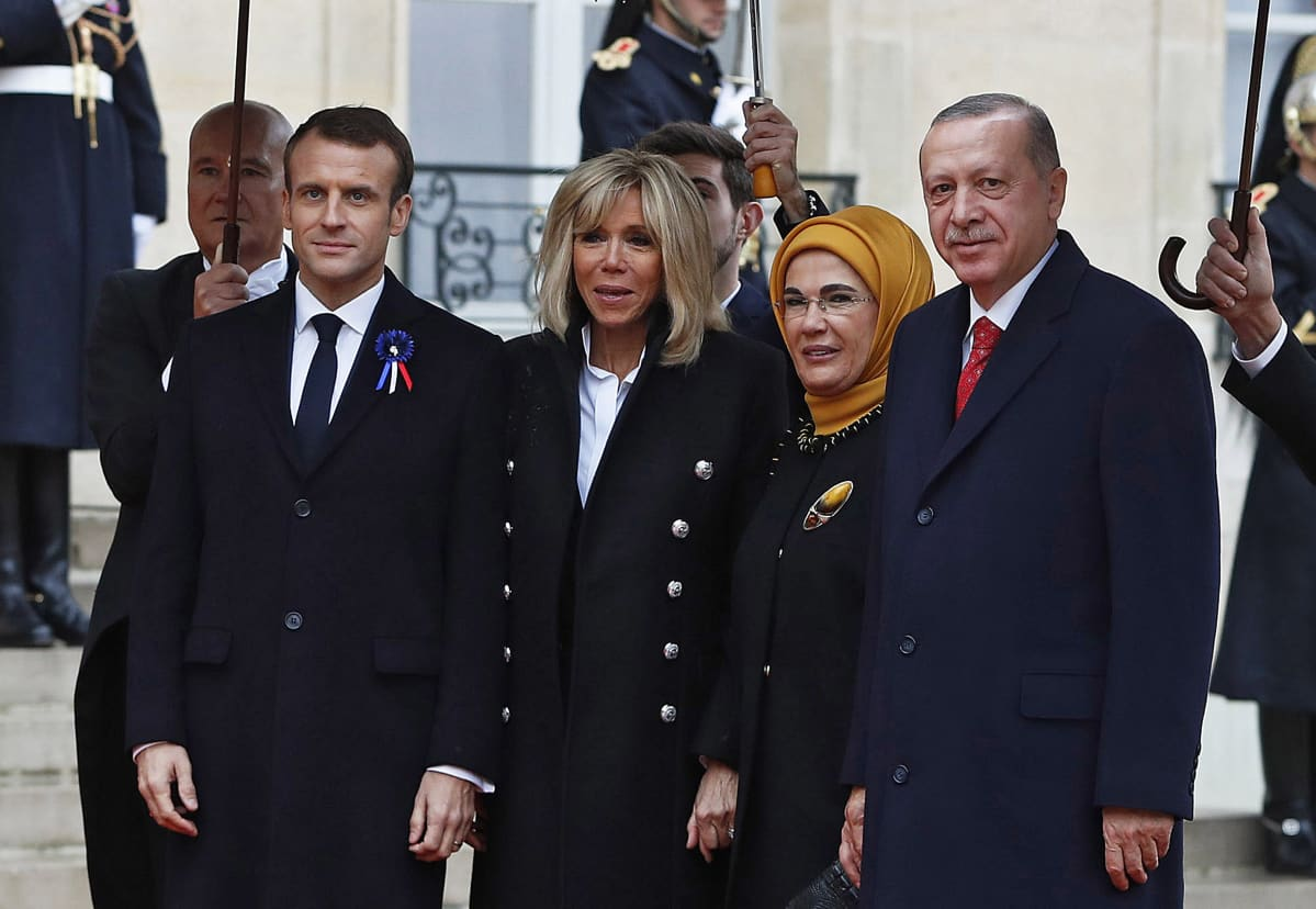 French President Emmanuel Macron (L) and his wife Brigitte Macron (2-L) welcome Turkish President Recep Tayyip Erdogan (R) and his wife Emine Erdogan (2-R) at the Elysee Palace ahead of the international ceremony for the Centenary of the WWI Armistice of 11 November 1918, in Paris, France, 11 November 2018. World leaders have gathered in France to mark the 100th anniversary of the First World War Armistice with services taking place across the world to commemorate the occasion.