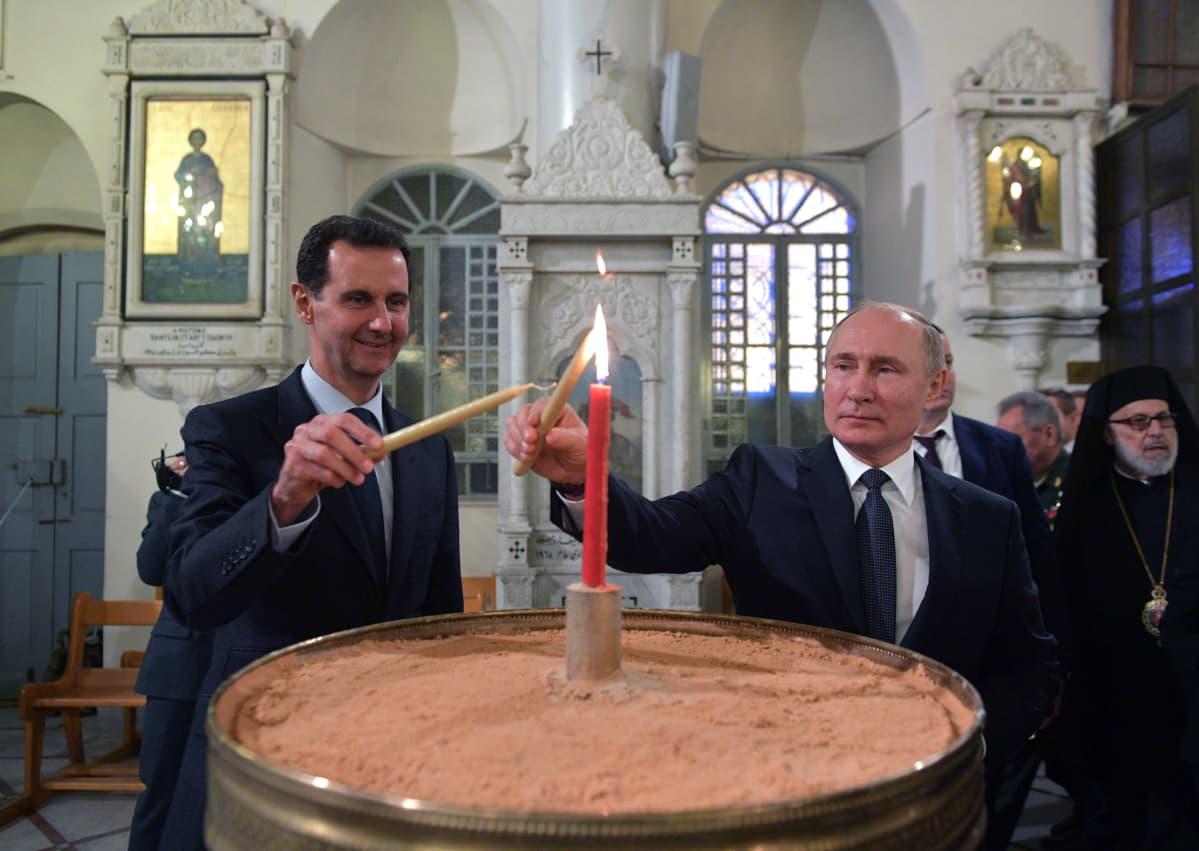 Syyrian presidentti Bašar al-Assad ja Vladimir Putin Damaskoksessa tammikuun alussa.