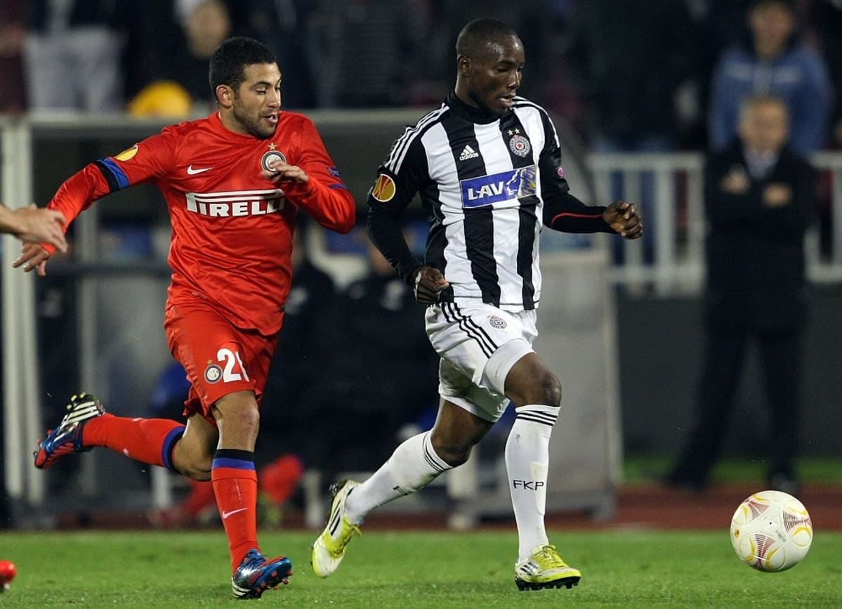 Inter Milan's Walter Gargano (L) fights for the ball with Partizan's Medo (R) during their UEFA Europa League group match in Belgrade, Serbia, 08 November 2012.