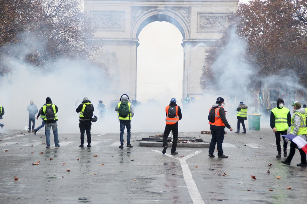 Yellow Vest protestors clash with French riot police and security forces on the Champs Elysees in Paris.