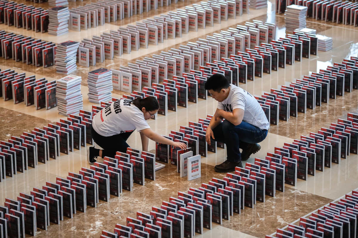 People install a domino books titled 'Just do it! Do it easy!' by German-Russian businessman Oskar Hartmann prior to attempt to set the book dominoes world record in Moscow, Russia, 14 February 2020. All 15,000 books toppled in the dominoes.