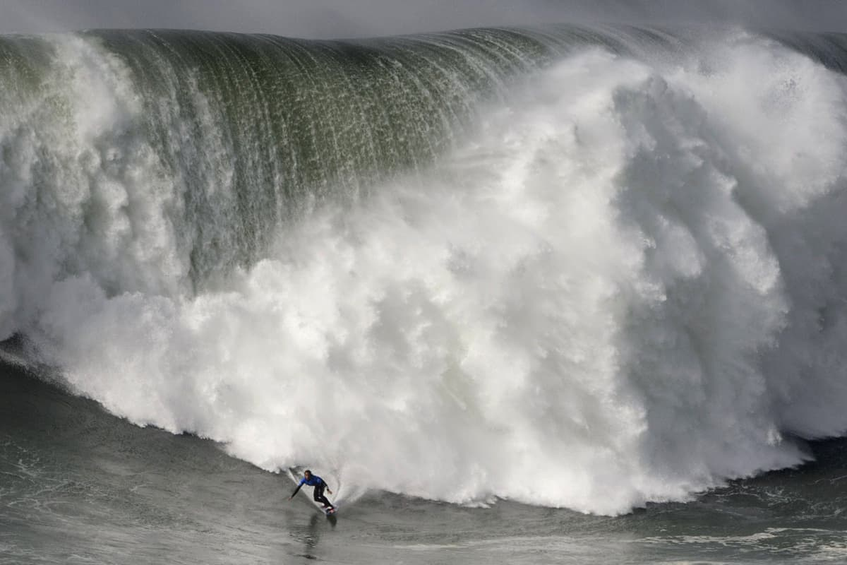 Hawaiian surfer Kai Lenny rides a wave during the big waves Nazare Tow Surfing Challenge in Nazare, on February 11,