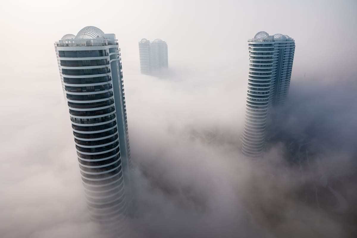 Skyscrapers are enveloped by fog in Huludao city, north-east China's Liaoning province Fog in downtown Huludao city, Liaoning province, China - 10 Feb 2020