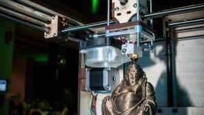 3D-printteri tulostaa Buddha-patsasta.