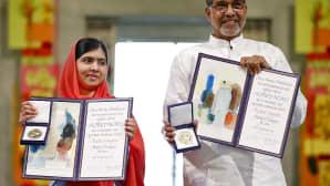 Malala Yousafzai ja Kailash Satyarthi mitall käsissään