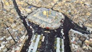 Ilmakuva näyttää imaami Abbas ibn Alin pyhätölle kerääntyneitä shiiamuslimeja Karbalan kaupungissa Irakissa 1. joulukuuta.