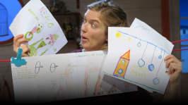 Lisa tittar på teckningar