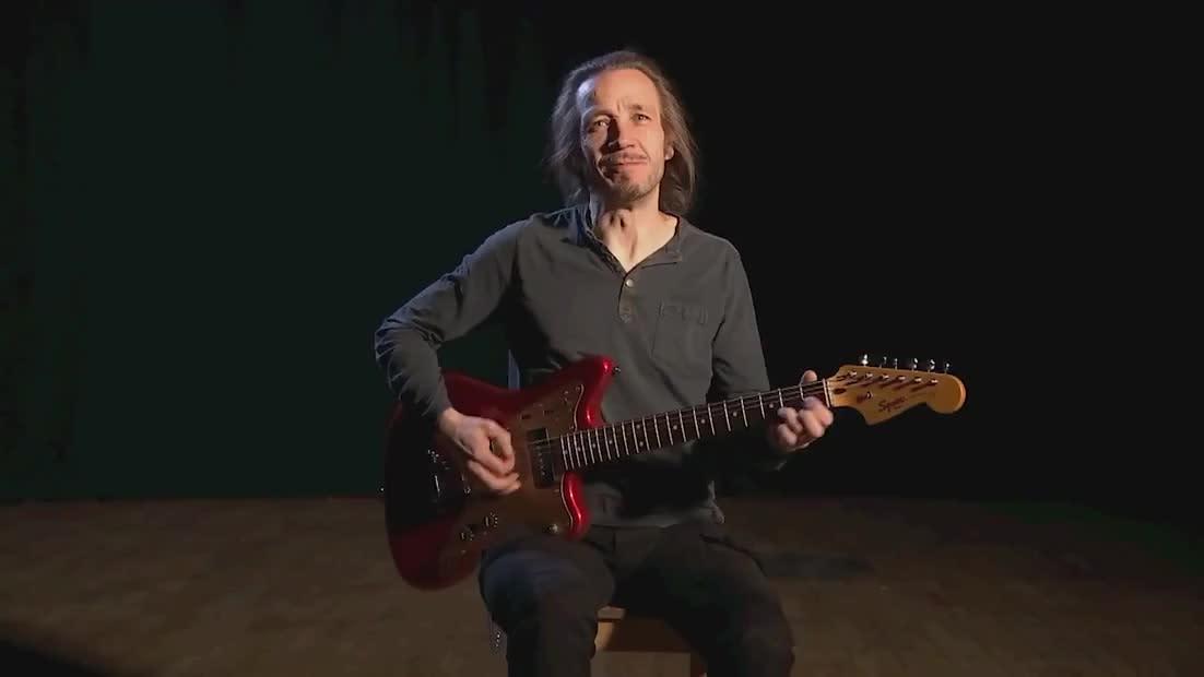 Musician Jarkko Martikainen plays guitar.