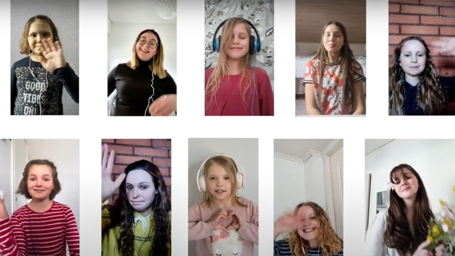 Tyttökuoro Imatran Neiet -esiintyy videolla.