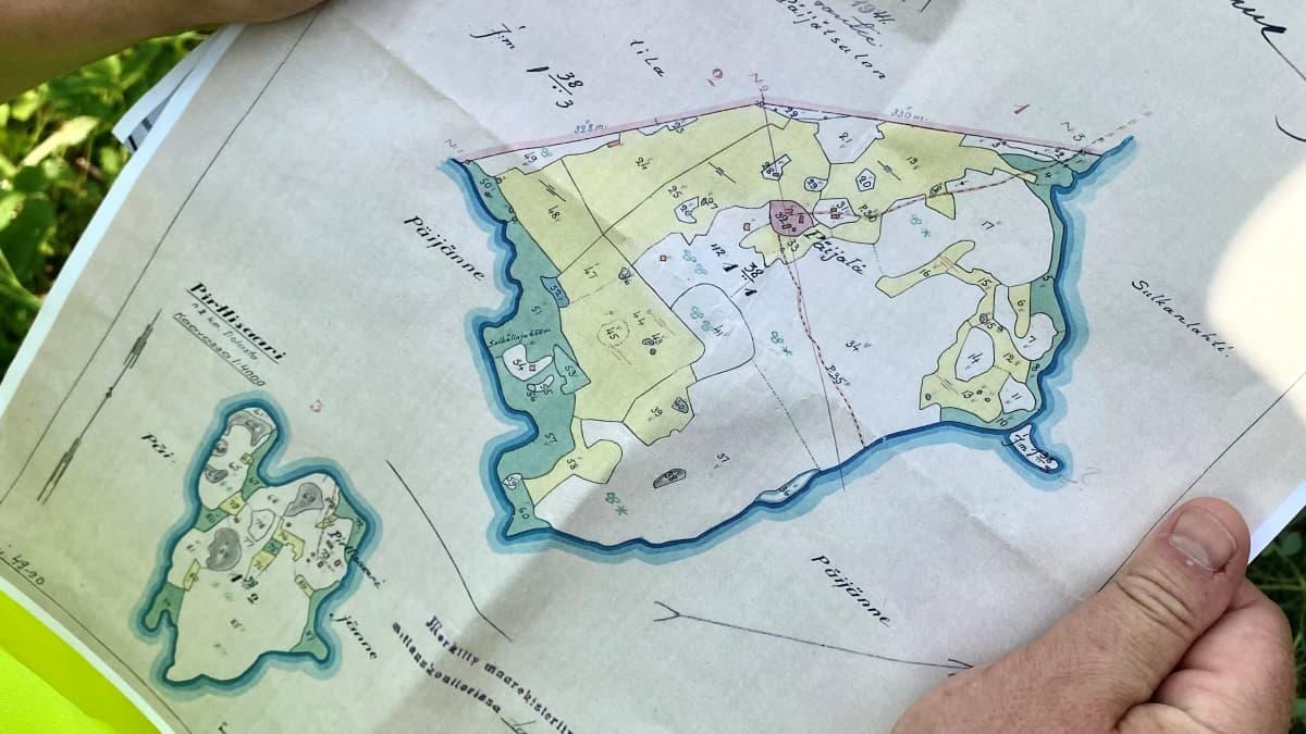Vanha toimituskartta, johon on piirretty kiinteistöjen rajoja.