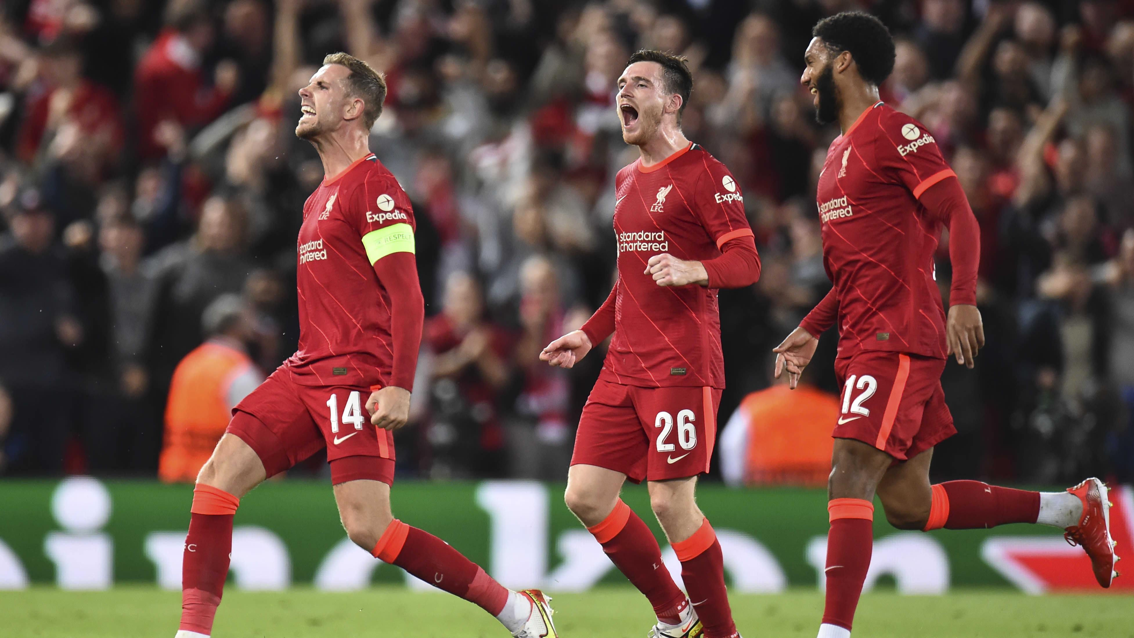 Jordan Henderson (vas.) tuulettaa Liverpoolin voittomaalia.
