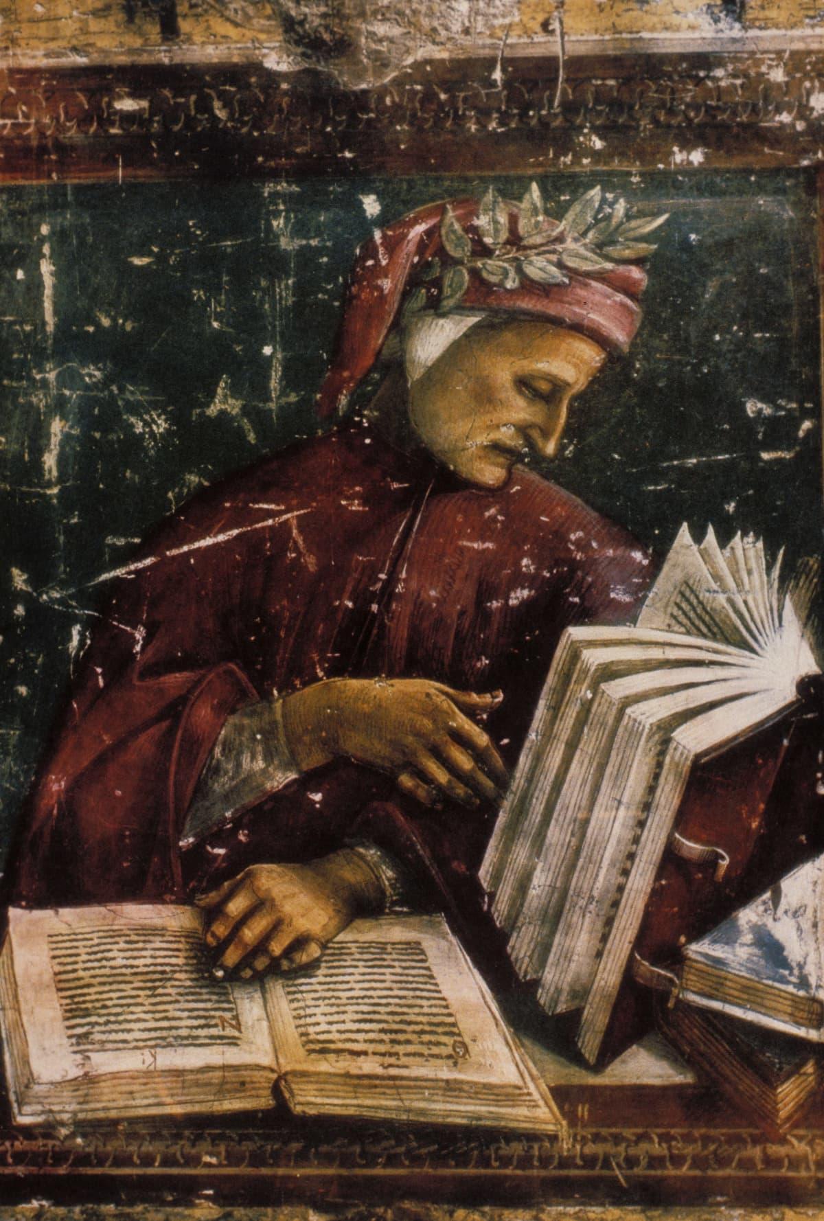 Dante kirjojensa parissa seppele päässä.