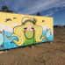 Inna Pulkkisen eli Poppamaijan tekemä graffiti, jossa vaaleahiuksisen tytön molemmilla puolilla ovat saimaannorpat.