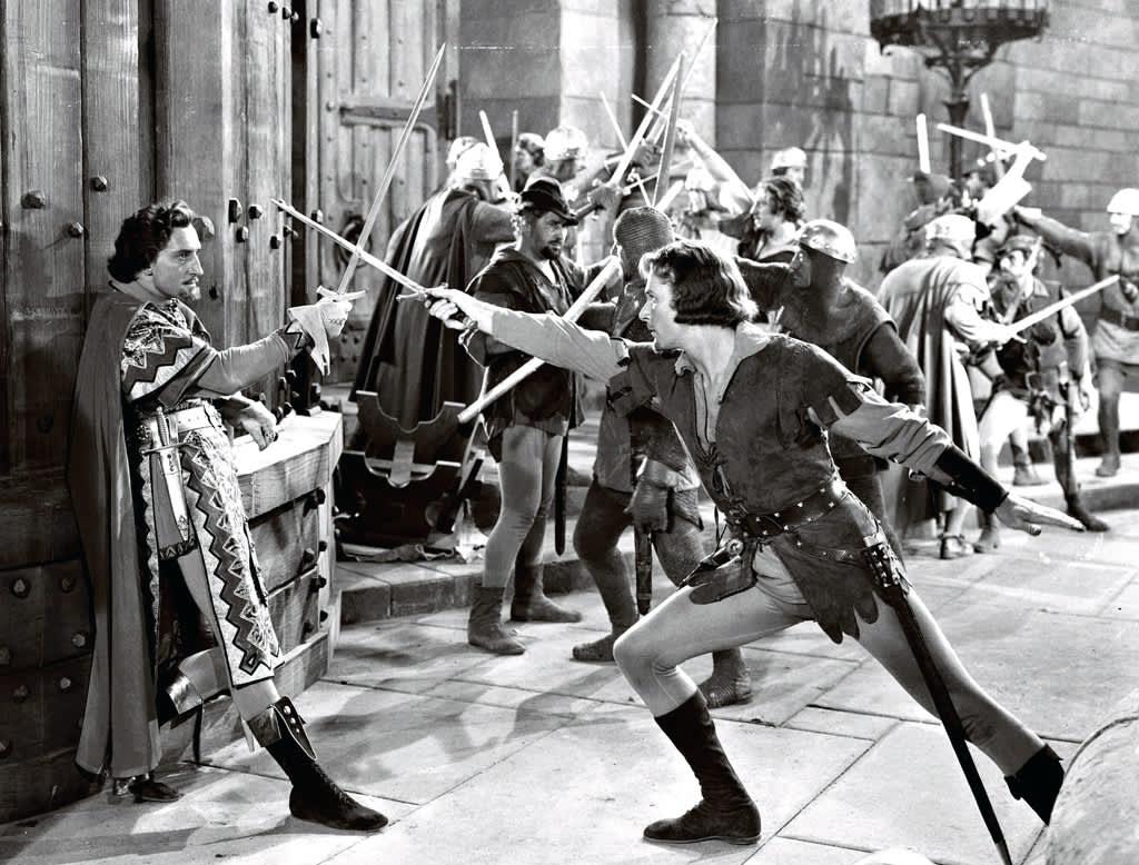 Errol Flynn miekkailee Robin Hood -elokuvassa.