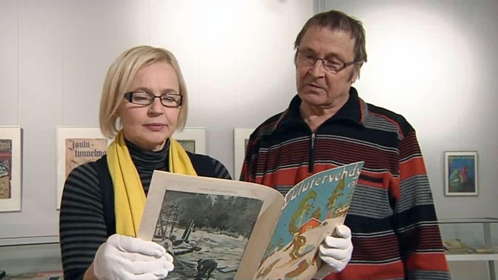 Meri-Anne Rossander ja Heimo Vattulainen katselevat joululehteä.