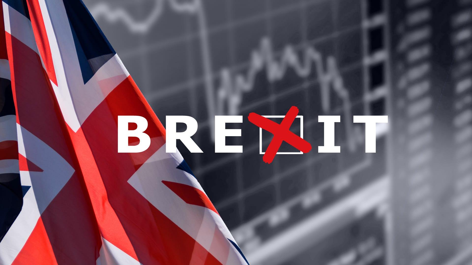 Britannian lippu ja pörssikäyrä.