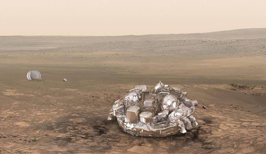 Piirroskuva metallisesta laskeutujasta ja sen laskuvarjosta Marsin kivisellä tasangolla.