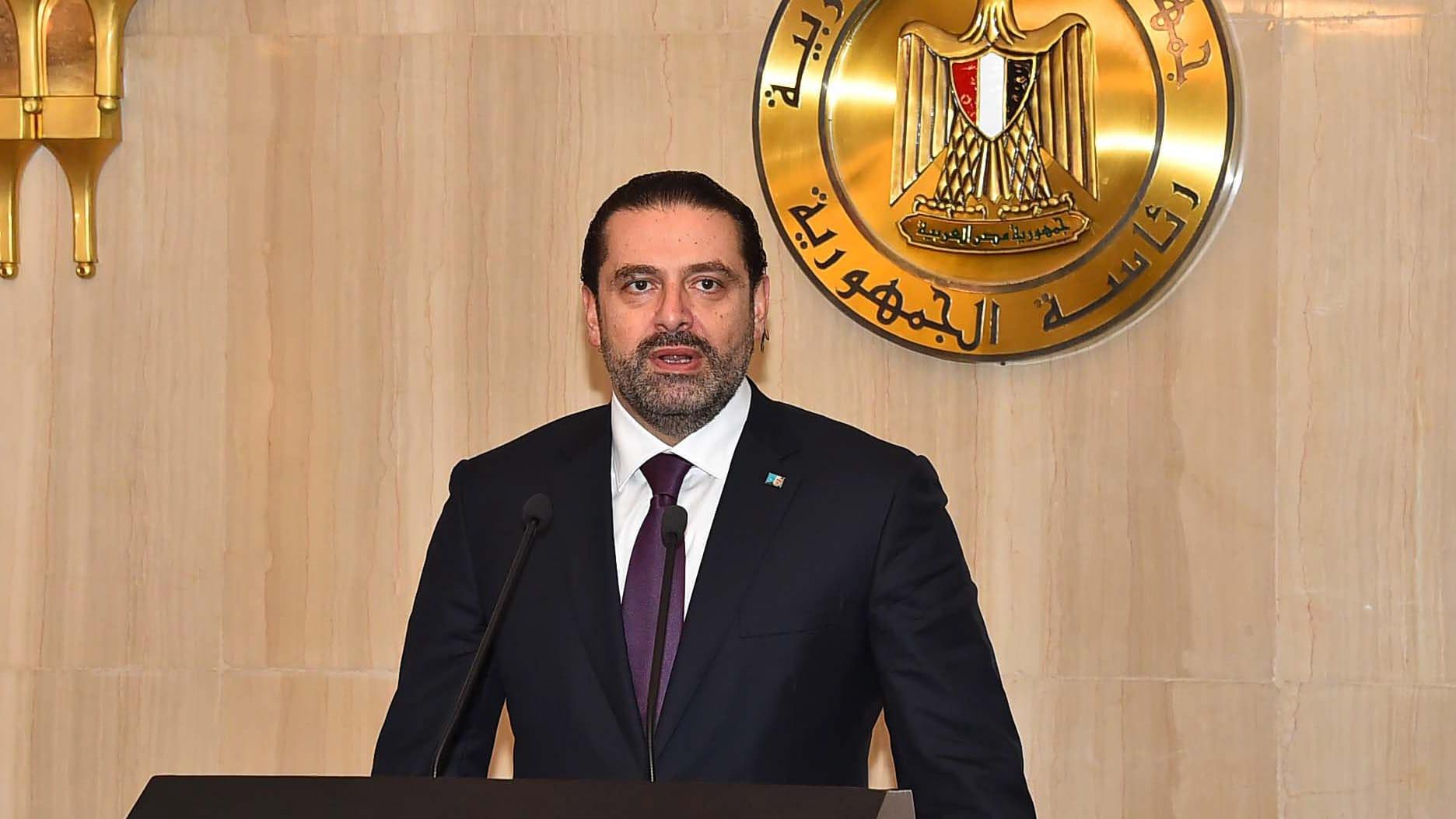 Saad Al-Hariri, taustalla Egyptin vaakuna.