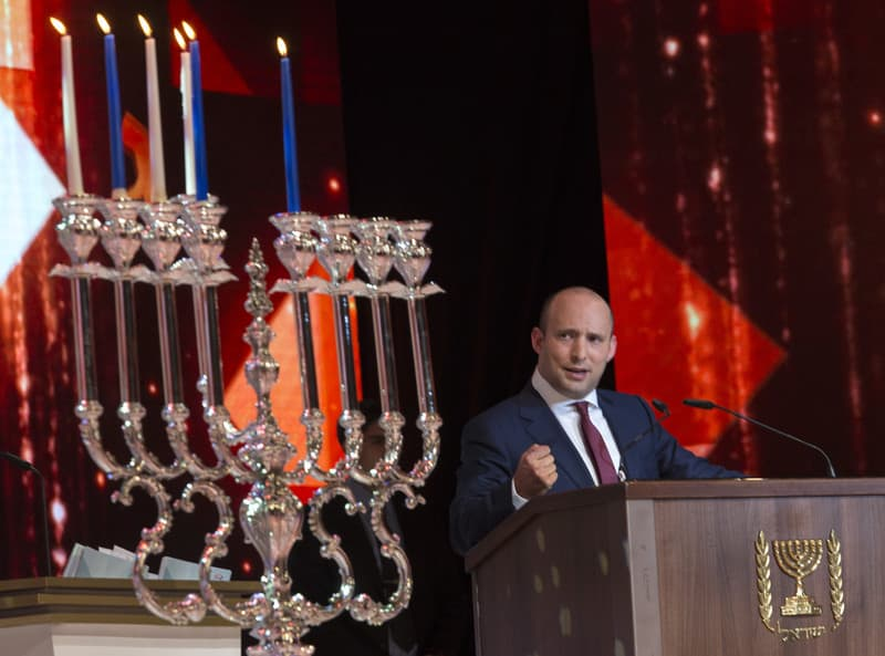a05690267 Israeli Minister of Education, Naftali Bennet speaks in English and specifically to US Secretary of State John Kerry after lighting candles on a Menorah for the Jewish holiday of Hanukkah in Jerusalem, 28 December 2016. Bennet stressed the Jews have been lighting Hanukkah candles in Jerusalem for over 1800 years and called the UN Security Council resolution on Israel settlements 'shameful.'