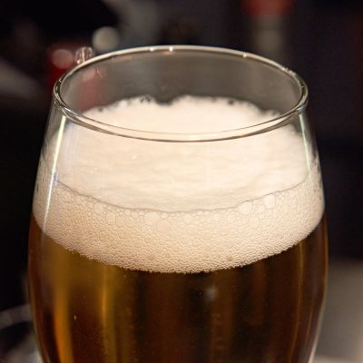 A foaming glass of beer.